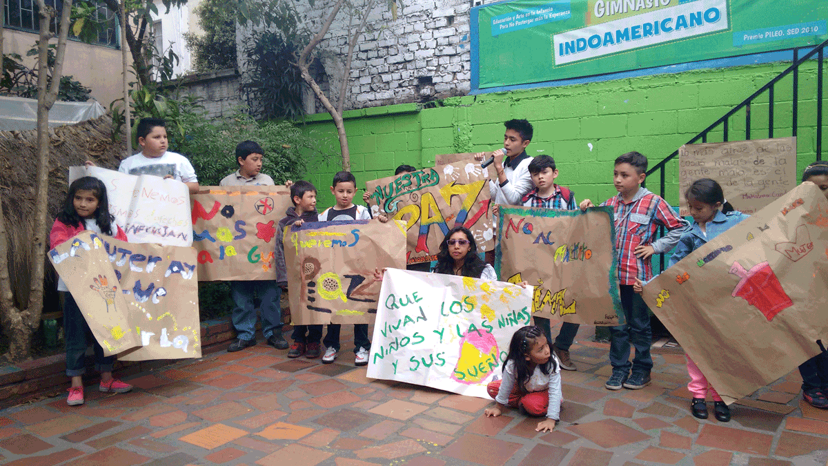 CEPALC - photo of children from Colombia with paintings