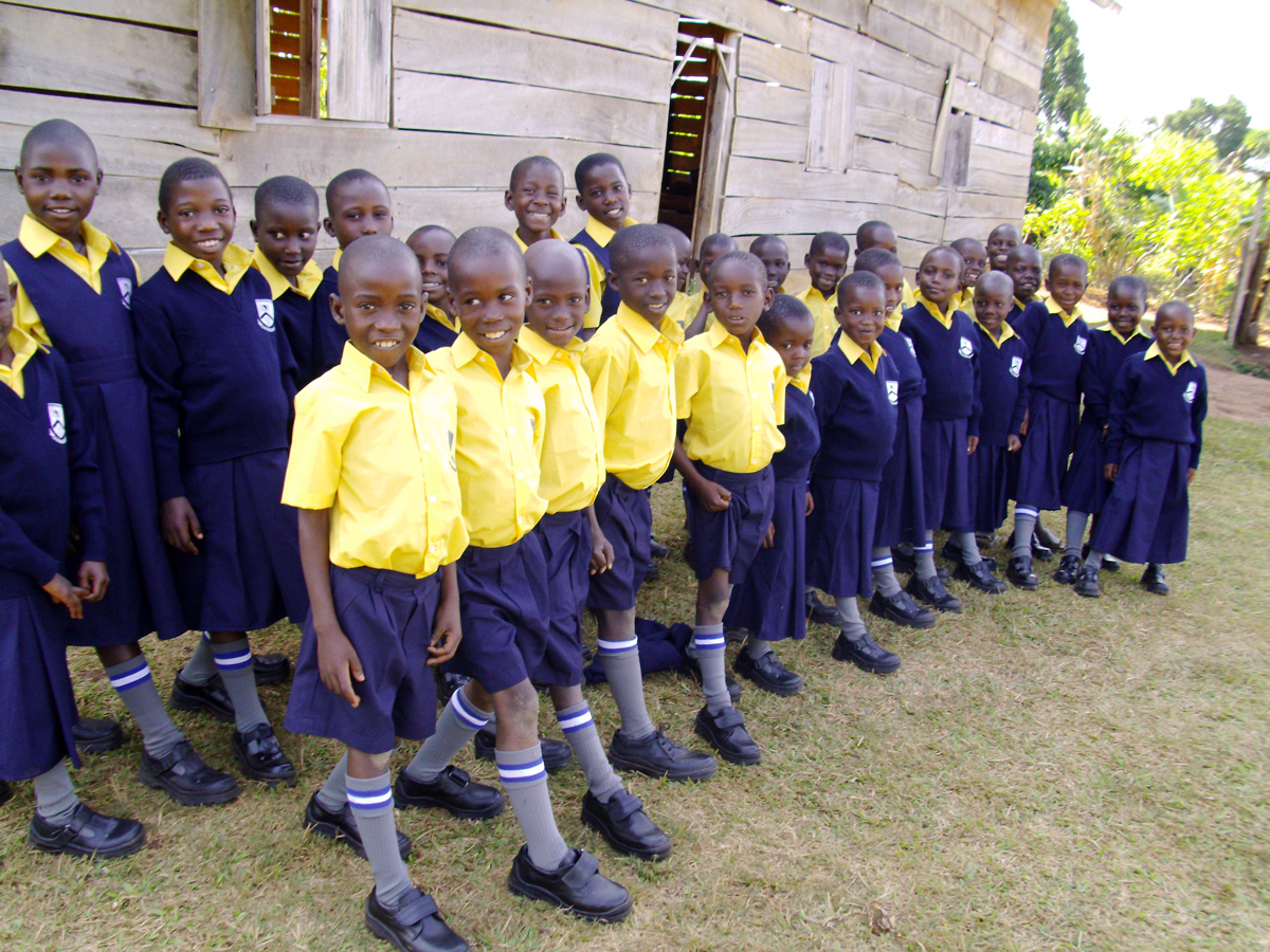 Raise the Roof - Ugandan school children in blue and yellow uniforms