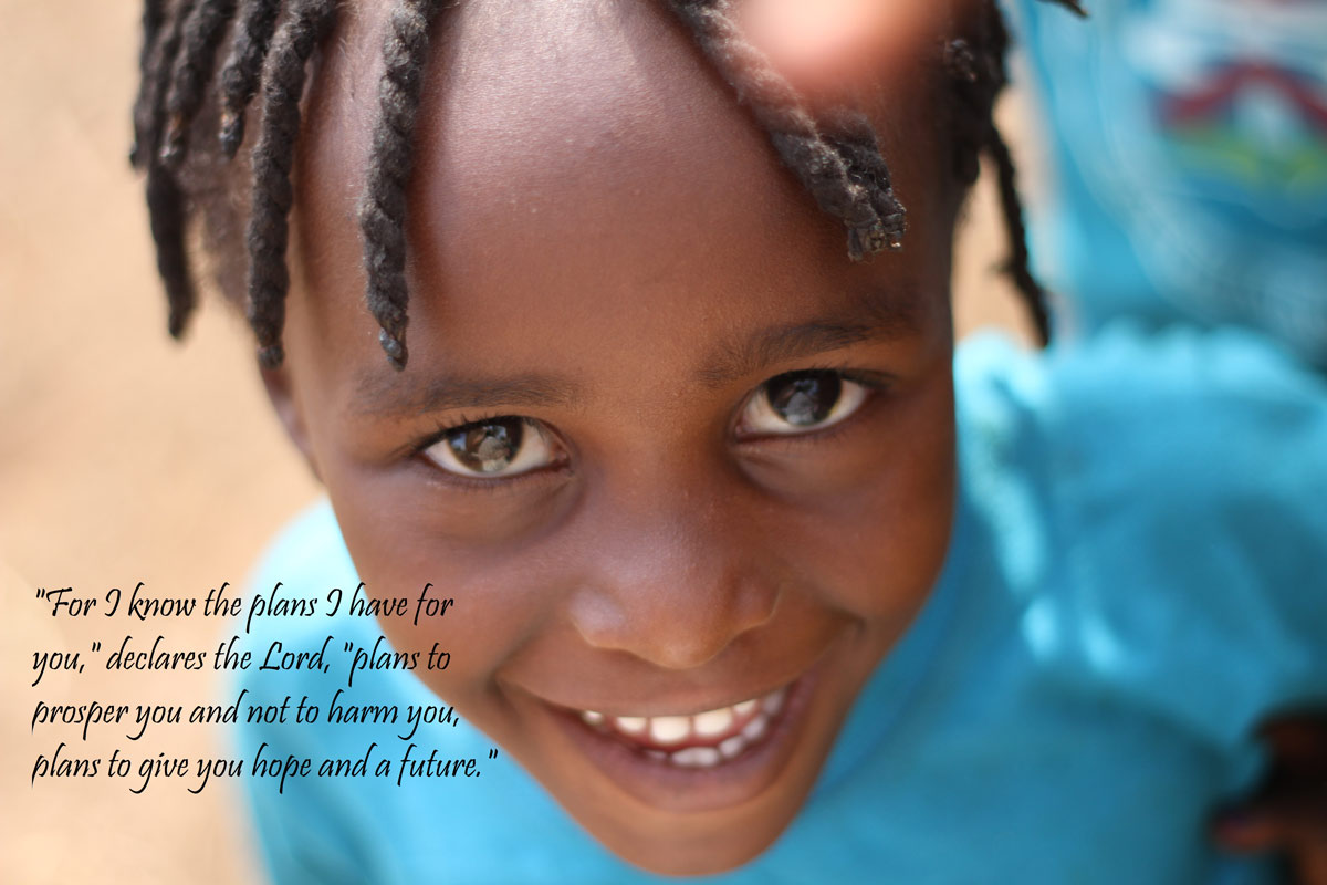 Ugandan child with Jeremiah 29:11