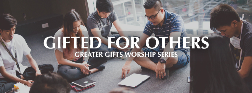 Greater Gifts: Gifted for Others - over group of young adults sitting in a circle with heads bowed