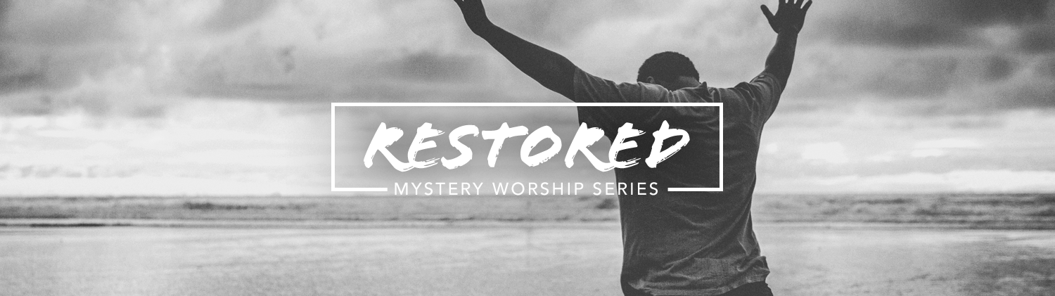 Mystery: RESTORED worship series text over black and white photo of a man with his head bowed and hands raised